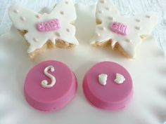 Pink chocolate covered Oreos with monogram and baby feet