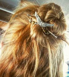 Angel Wings flexi hair clip in a cute half up messy bun style.