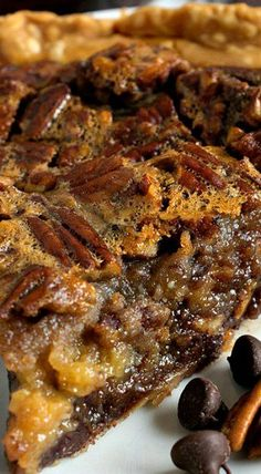 Chocolate Bourbon Pecan Pie - A Family Feast® This Chocolate Bourbon Pecan Pie takes a classic dessert – pecan pie – then kicks it up a few notches with the addition of chocolate chips and Bourbon to the filling! Mini Desserts, Classic Desserts, Just Desserts, Delicious Desserts, Yummy Food, Bourbon Recipes, Pecan Recipes, Sweet Recipes, Baking Recipes