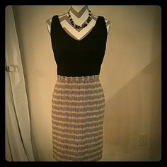 Ann Taylor sheath dress Sleeveless, v-neck, back zipper, gently worn but in very good condition. Ann Taylor Dresses