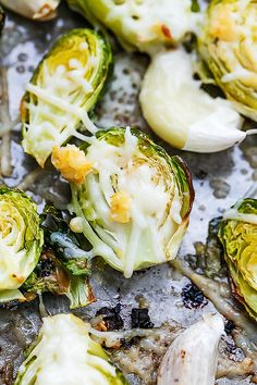 Roasted Garlic Brussel Sprouts by lecremedelacrumb: Love the melty parmesan cheese. #Brussel_Sprouts #Garlic #Parmesan