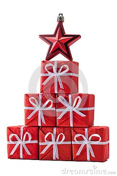 Christmas tree made of Santa's gifts with Red Star isolated on white.