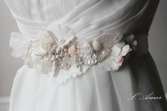 Items similar to Ornately Decorated Starfish and Seashell Beach Wedding Sash belt, Bridal Belt on Embroidered Lace Flower Underlay-L'Amei on Etsy Seashell Wedding, Seaside Wedding, Rustic Wedding, Seashells, Starfish, Wedding Dress Sash, Wedding Dresses, Lace Flowers, Embroidered Flowers