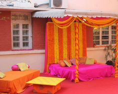 Mandap and a matress with a fitted sheet over it