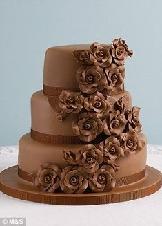 This classic rose sponge wedding cake, £199, right, decorated with a cascade of soft icing roses