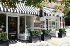 Liz Caan interior design store. Striped awning, boxwoods
