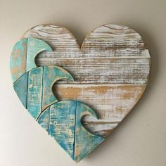 Our blue wave heart, created from our own design and crafted with reclaimed lumber. Each board is carefully chosen and hand sanded. The shapes are cut out, painted and then sanded again before assembly. The heart is assembled with both wood glue and nails Beach Wood, Beach Art, Beach Themed Art, Arte Pallet, Bois Diy, Reclaimed Lumber, Beach Signs, Beach House Decor, Beach Houses