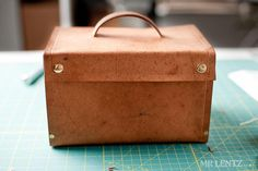 Leather Lunch Box -- this could be great in different sizes, maybe with wood on the bottom as well.  Maybe even a shoulder strap riveted or screwed to the wood sides