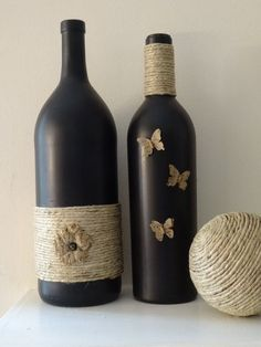 Black painted wine bottle with twine and butterflies Wine Bottle Vases, Glass Bottle Crafts, Painted Wine Bottles, Diy Bottle, Bottles And Jars, Glass Bottles, Decorated Bottles, Wine Glass, Diy Crafts Hacks