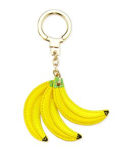 """kate spade new york leather bananas key fob. Light golden hardware. Easy slide keychain closure. Approx. 6""""H x 1.6""""W. Imported."""