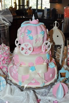 Cinderella carriage baby shower cake pumpkin carriage pink and