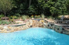 This customer of All Seasons Pools and Spas added a beautiful fountain with a natural stone wall.