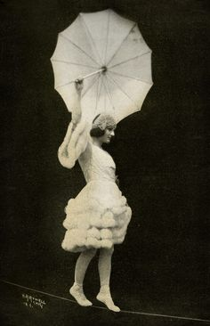 Tightrope walker & umbrella (Photographer/year unknown)