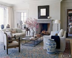 White walls; Grey fireplace; persian rug. Living Room Decorating: A-List Designers - ELLE DECOR