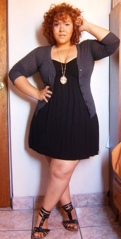 Little black dress with cardigan and strappy sandals.