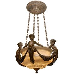 Cherub Chandelier  | From a unique collection of antique and modern chandeliers and pendants at https://www.1stdibs.com/furniture/lighting/chandeliers-pendant-lights/