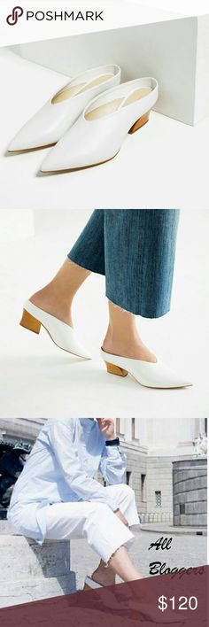 Zara leather mules (1220) New with tag. EUR 36 US 6. UPPER 100% cow leather LINING 100% polyurethane SOLE 100% vulcanized rubber SLIPSOLE 80% goat leather, 20% polyurethane  Mid-heel white leather mules with contrasting wood effect heels. Pointed toes. Heel height of 5 cm. Zara Shoes Mules & Clogs