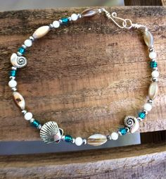 A personal favorite from my Etsy shop https://www.etsy.com/listing/532009816/anklet-nautical-theme-with-natural-shell
