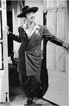 """Luis Valdez in a zoot suit / 1945.  The zoot suit was a source of pride among #Pachucos.  It originated in Harlem and became especially popular during WWII when the extravagant style was seen as """"unpatriotic.""""  It conveyed political resistance and played a major role in the Zoot Suit Riots.  #subvert1940s"""
