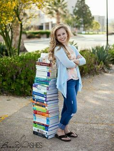 I want to do this when I graduate!  Only I'll be wearing my flight suit and have my helmet perched on top of the books.