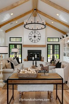 The great room in this Modern Farmhouse home features a custom painted brick and shiplap fireplace with a wood stained mantle that coordinates with the natural wood beams of the vaulted ceiling. Vaulted Living Rooms, Home Living Room, Open Kitchen And Living Room, Living Room Wood Floor, Dining Room, Living Room Designs, Shiplap Fireplace, Shiplap Ceiling, Home Decor Ideas