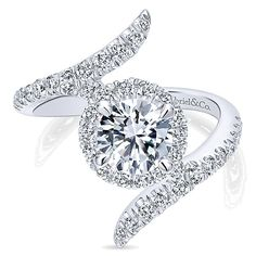 Take the traditional round halo diamond engagement ring and give it a twist. This stunning style features of sparking G color and SI clarity round diamonds in a flared bypass style, accenting Unique Diamond Engagement Rings, Three Stone Engagement Rings, Halo Rings, Buy Diamond Ring, Diamond Jewelry, Silver Stacking Rings, Blue Sapphire Rings, Emerald Rings, Perfume