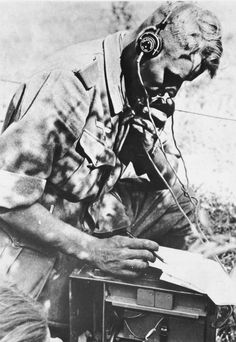 World War II German soldier on field phone. Date... - Historical Times