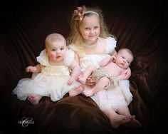 The Newest Cousin    Family Portraiture  by Cathy Rosselli Studios