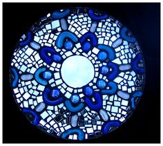 1 - 10 inch melamine plate, 1 bag blue squiggles, 3 mirrors for candles, 1 bag blue glass gems and 1 bag clear glass gems.