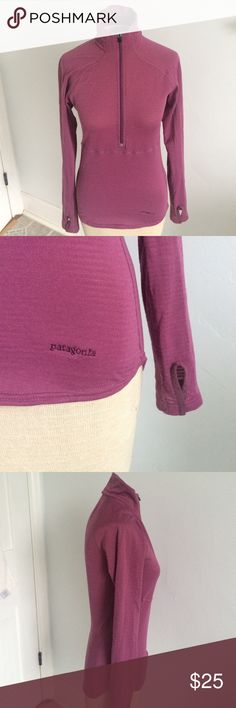Patagonia women's XS thermal shirt Lightweight but warm, waffle-weave women's Patagonia XS plum/pink colored thermal.  Warm and cozy with thumb holes. Slightly tapers longer in the back.  Great condition other than tiny tear near right sleeve. See last photo for detail. Patagonia Other
