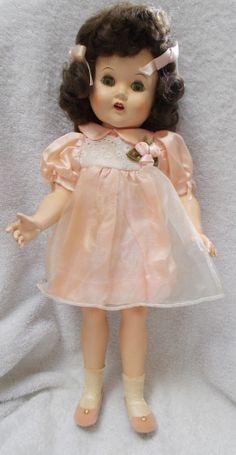 "17"" vintage hard plastic walker doll --teeth and felt tongue--very pretty!"