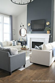fireplace transformation with paint! Fireplace wall color is Cyberspace from Sherwin-Williams. It's an absolutely PERFECT dark gray/blue. Sometimes it looks navy, sometimes it's more dark gray.Fireplace wall color is Cyberspace from Sherwin-Williams. Navy Living Rooms, Accent Walls In Living Room, Living Room Paint, Living Room Colors, New Living Room, Living Room Designs, Living Room Furniture, Living Room Decor, Funky Furniture
