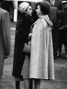 A Sister Affair It could be from a fashion supplement.The Queen Elizabeth II in a cape, with her sister Princess Margaret when they turned up for race meeting at Ascot. Elizabeth Philip, Queen Elizabeth Ii, Hm The Queen, Save The Queen, Princess Anne, Royal Princess, Queen And Prince Phillip, Prince Philip, British Monarchy