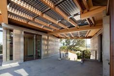 rammed earth house - d2b design  solar panel shade!