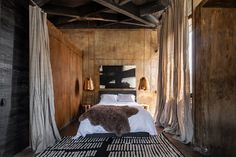 This stylish six room eco-retreat is set in a mezcal distillery one hour east of Oaxaca City, off the beaten path in a state increasingly explored by international travelers. An assemblage of compacted dirt walls, reclaimed wood, and loads of terra-cotta, it creates a space that feels at home among a landscape dotted with agave plants.
