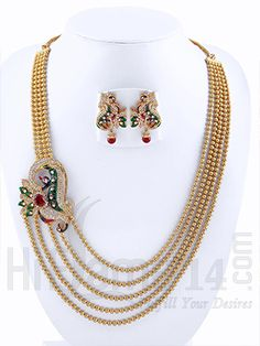 RENT : A splendid, peacock inspired side #pendant with glamorous #multicolor work and #AmericanDiamond stones to deck up your attire. The multi line classy #goldbeads #chain and elegantly crafted #earring with red #beadhanging matches well for your #Indianethnicwear.