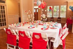 Red Riding Hood Party- love the aprons tied to the chairs!
