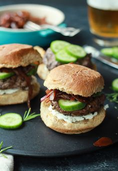 Grilled Lamb Burgers With Whipped Feta And Cucumbers With Ground Lamb, Pepper, Salt, Slider Buns, Onions, Mini Cucumbers, Garlic Cloves, Feta Cheese Crumbles, Cream Cheese, Fresh Rosemary, Chopped Fresh Thyme