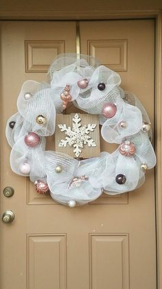 Simple white, silver, and pink mesh wreath.