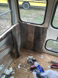 Experimenting with reclaimed barn wood walls. - tiny house school bus conversion, Tristan Beache