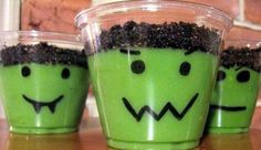 Frankenstein cups - Halloween  Use a sharpie to draw face on small clear plastic cups. Add vanilla pudding with green food coloring to each. Crush Oreo cookie and sprinkle on top.