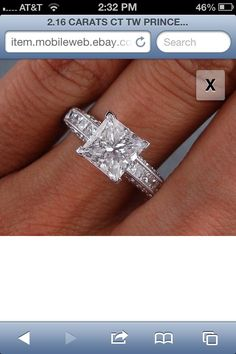 Perfect.. Princess cut engagement ring. Love the band but the solitaire could be smaller.