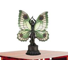 Grace your table with a lovely Meyda Tiffany Butterfly Table Lamp.