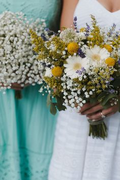 Kelly's beautiful garden-style bouquet created with Baby's Breath, miniature Gerbera daisies, Craspedia, Solidago, lavender and assorted garden flowers. Kelly's Bridesmaids carried full bouquets of Baby's Breath.