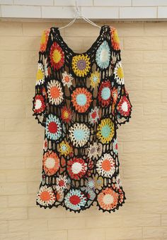 Bohemian crochet dress with flower in clolr splash. You can wear it at party, featival occation, wedding, beach or everyday you want to feel good. It is a must-have piece for your wardrobe. It can be made with long sleeve dress, elbow sleeve, short sleeve or even tank dress. We can do