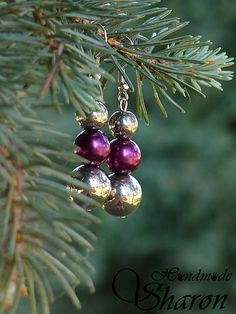 Metallic handmade earrings with metal beads in silver and purple color