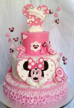 A very beautiful Minnie mouse birthday cake in pink and with a Minnie mouse head. A very beautiful Minnie mouse birthday cake in pink and with a Minnie mouse head topping. Torta Minnie Mouse, Minnie Mouse Cookies, Bolo Minnie, Minnie Mouse Birthday Cakes, Mickey Cakes, Minnie Cake, Baby Birthday Cakes, Mickey Mouse Cake, Girl Cakes