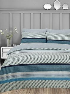 Add a modern flare to your bedroom with the reversible Brent duvet set. The duvet cover features a selection of geometric patterns with stripes of varying weights, and is finished with a triangle based patterns in varying teal, ochre, grey and white tones. The reverse features a geometric striped pattern.