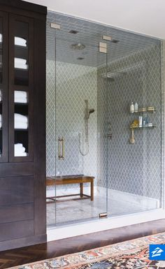 Take your shower experience to the next level with a teak bench and tile.