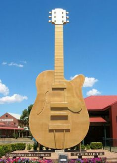 The Big Golden Guitar is a key attraction during the Tamworth Country Music Festival, an annual music festival held in Tamworth, New South Wales, Australia. Tamworth Country Music Festival, Tamworth Nsw, Bali, Country Music Awards, Country Singers, Roadside Attractions, Small Places, Australia Travel, New Zealand